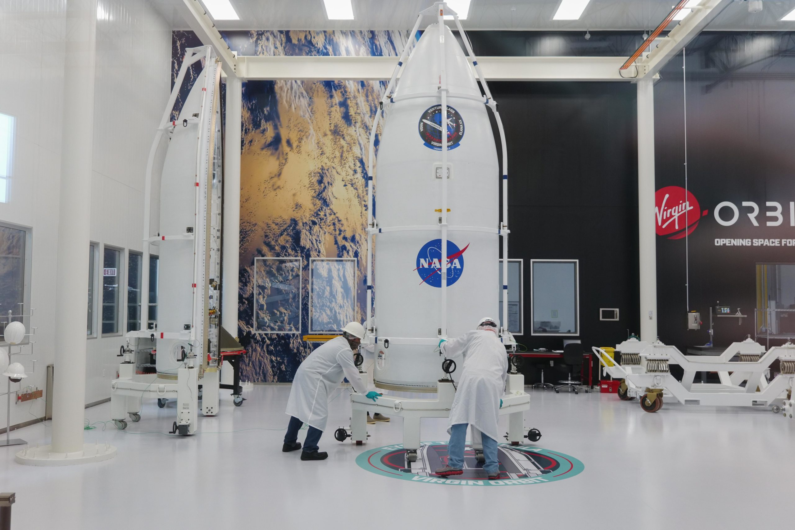 Virgin Orbit teammates complete a dry run of the payload encapsulation process last August inside its 'Nebula' payload processing facility ahead of the company's Launch Demo 2 mission. The payload has 10 small satellites, called CubeSats, including Cal Poly's 12th CubeSat, ExoCube 2. Virgin Orbit is gearing up for ELaNa 20, the Jan. 13 Launch Demo 2 flight from the Mojave Air and Space Port in California.
